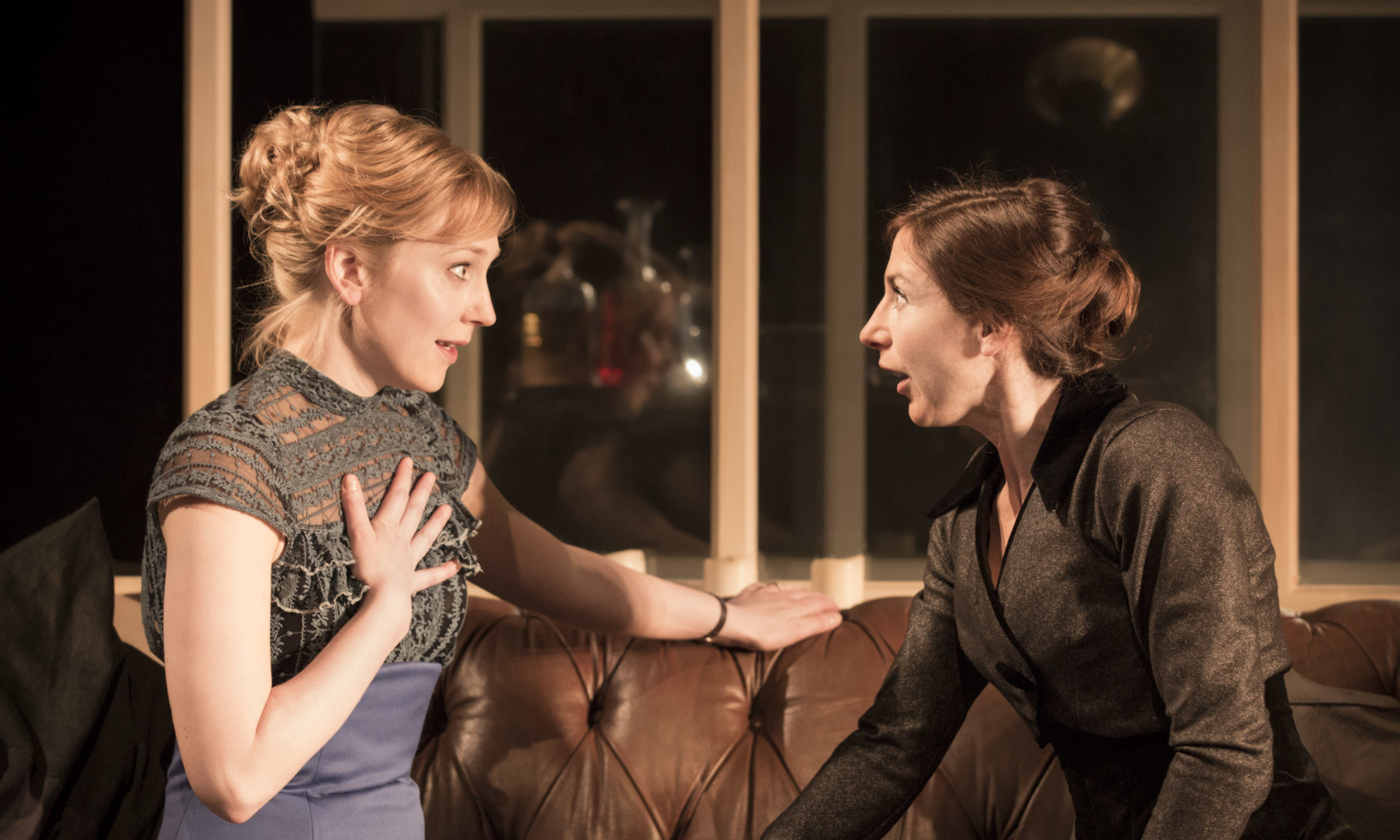 Hattie Morahan (Nora) and Susannah Wise (Kristine Linde) look at each other in shock in the Young Vic's A Doll's House © Johan Persson